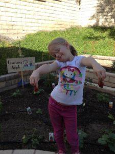 Our granddaughter Gigi loves the garden too!