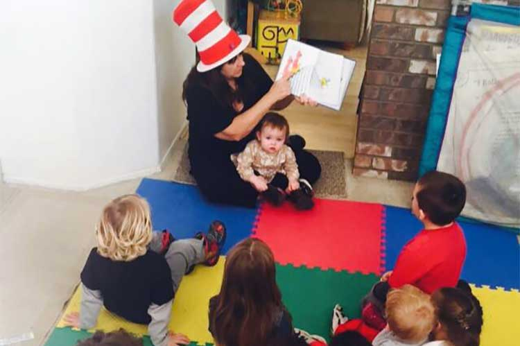 Mary Gregory Reads to Children During Story Time
