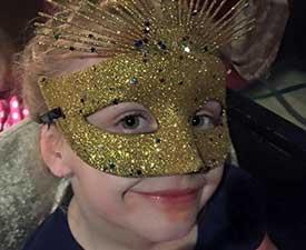Little Girl Wearing Circus Mask