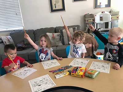 Kids With Hands Up While Drawing