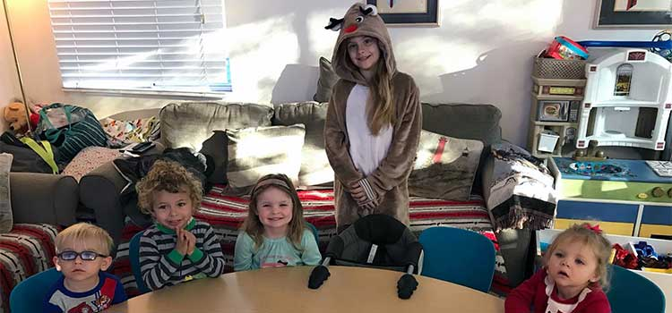 Teacher's Assistant Gianna Dresses Up as Reindeer for Christmas Party