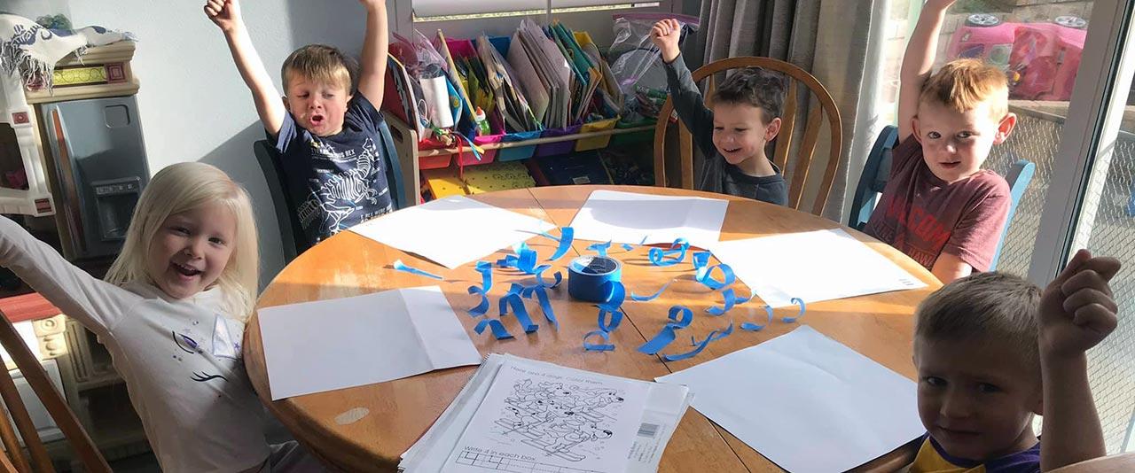 Older Children Working on Project
